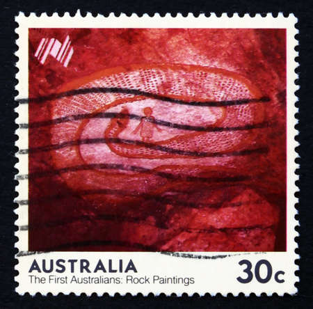 AUSTRALIA - CIRCA 1984: a stamp printed in the Australia shows Rock Python, Western Australia, The First Australians Rock Paintings, circa 1984