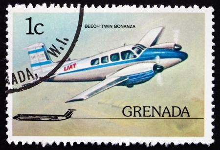 bonanza: GRENADA - CIRCA 1976: a stamp printed in Grenada shows Beech Twin Bonanza, Airplane, circa 1976 Editorial