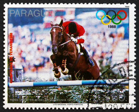 west of germany: PARAGUAY - CIRCA 1988: a stamp printed in Paraguay shows Hans-Guenter Winkler, West Germany, Equestrian, 1988 Summer Olympics, Seoul, circa 1988 Editorial