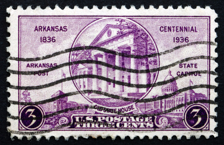 statehood: UNITED STATES OF AMERICA - CIRCA 1936  a stamp printed in the USA shows Arkansas Post, Old and New State Houses, Centennial of Arkansas Statehood, circa 1936