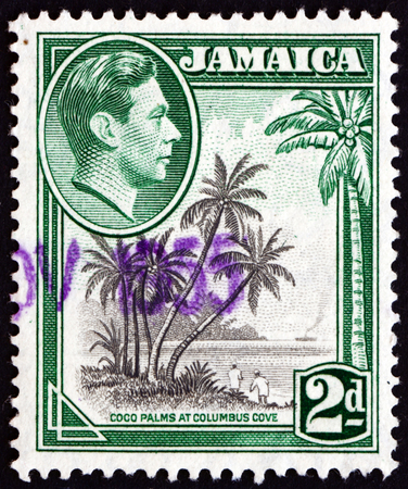 JAMAICA - CIRCA 1938  a stamp printed in Jamaica shows Coco Palms at Columbus Cove, circa 1938