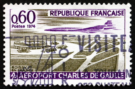 charles de gaulle: FRANCE - CIRCA 1974: a stamp printed in the France shows Concorde over Charles de Gaulle Airport, Paris, circa 1974 Editorial