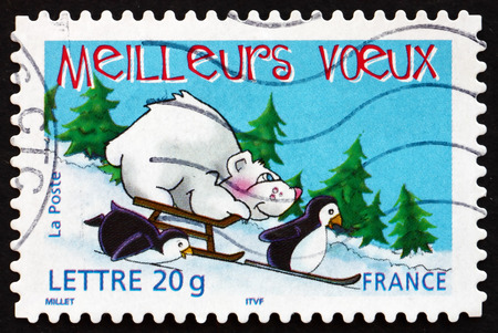 FRANCE - CIRCA 2005: a stamp printed in the France shows Two Penguins, Bear and Sled, Holiday Greetings, circa 2005