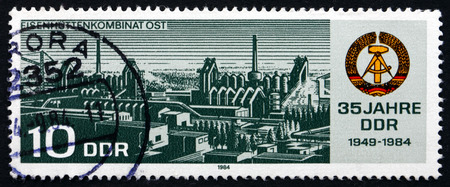 ironwork: GDR - CIRCA 1984: a stamp printed in GDR shows Ironwork Collective Combine East, circa 1984