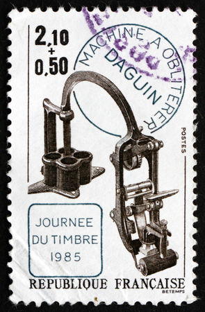 invented: FRANCE - CIRCA 1985: a stamp printed in the France shows Canceling Apparatus Invented by Eugene Daguin, circa 1985