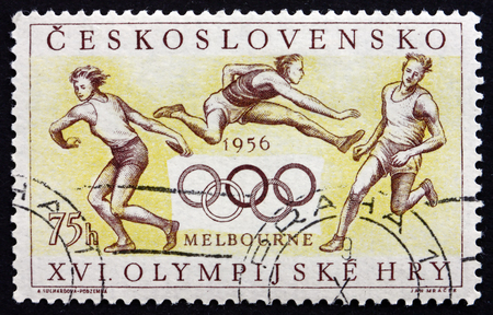 summer olympics: CZECHOSLOVAKIA - CIRCA 1956: a stamp printed in the Czechoslovakia shows Athletes and Olympic Rings, Summer Olympics, Melbourne, 1956, circa 1956 Editorial