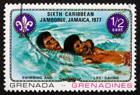 life saving: GRENADA AND GRENADINES - CIRCA 1977: a stamp printed in Grenada shows Swimming and Life Saving, 6th Caribbean Jamboree, Kingston, Jamaica, circa 1977