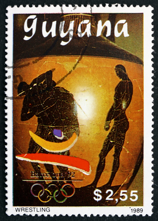 GUYANA - CIRCA 1989: a stamp printed in Guyana shows Wrestling, 1992 Summer Olympics, Barcelona, circa 1989
