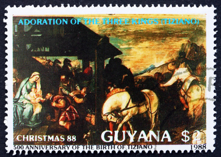 GUYANA - CIRCA 1988: a stamp printed in Guyana shows Adoration of the Magi, Painting by Titian, Christmas, circa 1988