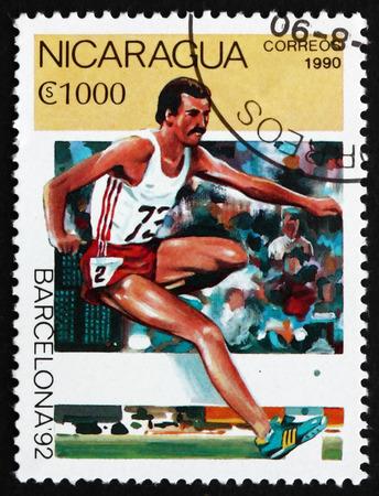 steeplechase: NICARAGUA - CIRCA 1990: a stamp printed in Nicaragua shows Steeplechase, 1992 Summer Olympics, Barcelona, circa 1990