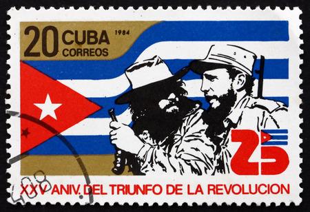 CUBA - CIRCA 1984: a stamp printed in the Cuba shows Fidel Castro and Ernesto Che Guevara, 25th Anniversary of the Revolution, circa 1984