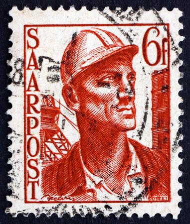 saar: GERMANY - CIRCA 1948: a stamp printed in the Saar, Germany shows Miner, circa 1948
