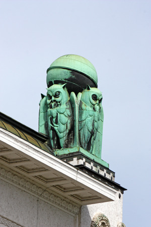 Owls, symbol of wisdom, on the roof of the Croatian national State Archives building in Zagreb photo