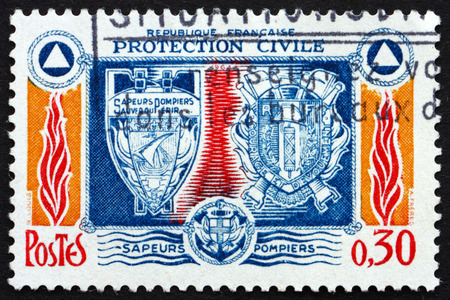 civilian: FRANCE - CIRCA 1964: a stamp printed in the France shows Fire Brigade Insignia, Symbols of Fire, Water and Civilian Defense, circa 1964 Editorial