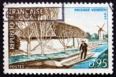 polling: FRANCE - CIRCA 1965: a stamp printed in the France shows Vendee River, Man Polling Boat and Windmill, circa 1965
