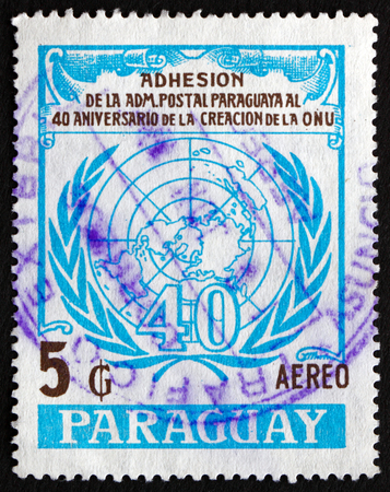 un: PARAGUAY - CIRCA 1986: a stamp printed in Paraguay shows UN Emblem, 40th Anniversary, circa 1986