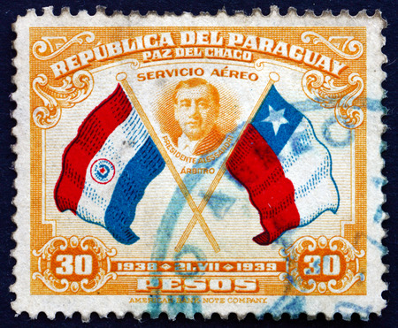 arturo: PARAGUAY - CIRCA 1939: a stamp printed in Paraguay shows President Arturo Alessandri, Flags of Paraguay and Chile, First Buenos Aires Peace Conference, circa 1939