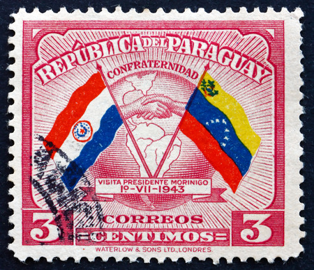 goodwill: PARAGUAY - CIRCA 1945: a stamp printed in Paraguay shows Handshake, Map and Flags of Paraguay and Venezuela, Colombia, Goodwill Visit of President Higinio Morinigo, circa 1945 Editorial