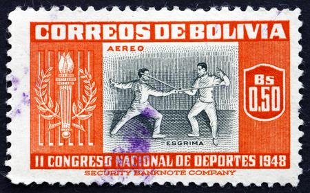 swordsmanship: BOLIVIA - CIRCA 1951: a stamp printed in the Bolivia shows Fencing, 5th Athletic Championship Matches, La Paz 1948, circa 1951