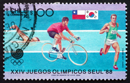 summer olympics: CHILE - CIRCA 1988: a stamp printed in the Chile shows Swimming, Cycling and Runing, 1988 Summer Olympics, Seoul, circa 1988
