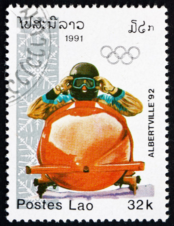 bobsled: LAOS - CIRCA 1991: a stamp printed in Laos shows Bobsled, 1992 Winter Olympics, Albertville, circa 1991