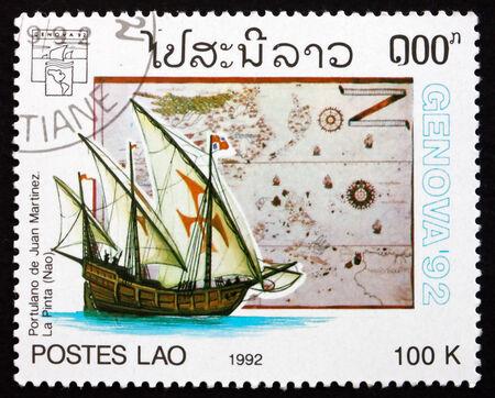 martinez: LAOS - CIRCA 1992: a stamp printed in Laos shows Sailing ship and Map by Juan Martinez, circa 1992