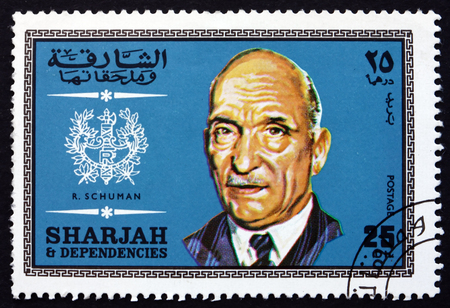 statesman: SHARJAH - CIRCA 1969: a stamp printed in the Sharjah UAE shows Robert Schuman, French Statesman, Twice Prime Minister of France, circa 1969