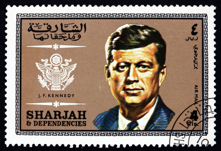 john fitzgerald kennedy: SHARJAH - CIRCA 1969: a stamp printed in the Sharjah UAE shows John Fitzgerald Kennedy, American Politician, 35th President of the United States from 1961 until 1963, circa 1969