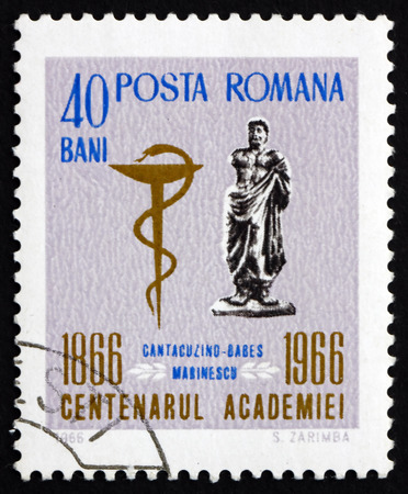 medical school: ROMANIA - CIRCA 1966  a stamp printed in the Romania shows Statue of Ovid and Medical School Emblem, Centenary of the Romanian Academy, circa 1966 Editorial