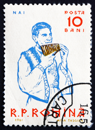 panpipe: ROMANIA - CIRCA 1961: a stamp printed in the Romania shows Peasant Playing Panpipe, Musical Instrument, circa 1961