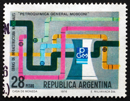 alberto: ARGENTINA - CIRCA 1976: a stamp printed in the Argentina shows Pipelines and Cooling Tower, General Mosconi Plant, circa 1976