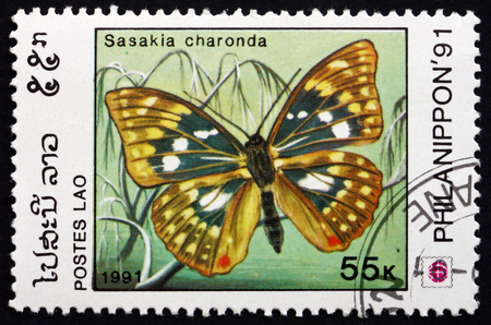charonda: LAOS - CIRCA 1991: a stamp printed in Laos shows Japanese Emperor, Sasakia Charonda, Butterfly, circa 1991 Editorial
