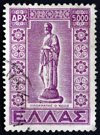 hippocratic: GREECE - CIRCA 1950: a stamp printed in the Greece shows Statue of Hippocrates of Cos, Ancient Greek Physician, circa 1950 Editorial