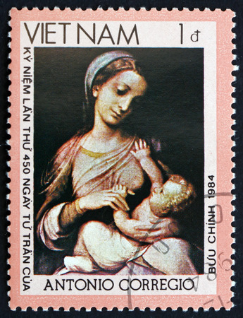 VIETNAM - CIRCA 1990: a stamp printed in Vietnam shows Madonna and Child, Painting by Antonio Corregio, circa 1990