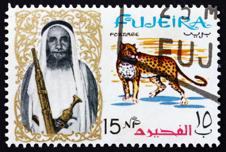 fujeira: FUJEIRA - CIRCA 1964: a stamp printed in the Fujeira shows Leopard and Sheikh Mohammed Bin Hamad Al Sharqi, circa 1964