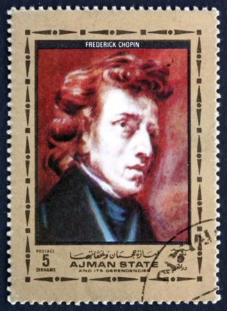 frederic: AJMAN - CIRCA 1972: un sello impreso en Ajman muestra Frederic Chopin, compositor y pianista polaco, pintura de Eugene Delacroix, pintor franc�s, alrededor del a�o 1972