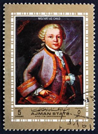 amadeus mozart: AJMAN - CIRCA 1972: a stamp printed in the Ajman shows Wolfgang Amadeus Mozart as Child, Austrian Composer, circa 1972