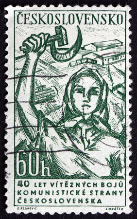 CZECHOSLOVAKIA - CIRCA 1961: a stamp printed in the Czechoslovakia shows Woman with Hammer and Sickle, circa 1961