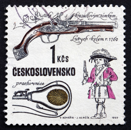 flintlock: CZECHOSLOVAKIA - CIRCA 1969: a stamp printed in the Czechoslovakia shows Flintlock Pistol, Devieuxe Workshop, Liege, c. 1760, Historical Firearm, circa 1969 Editorial