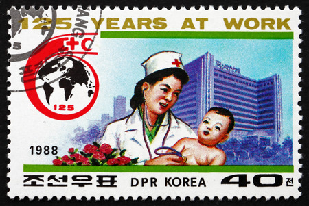 NORTH KOREA - CIRCA 1988: a stamp printed in North Korea shows Doctor Examining Child, Pyongyang Maternity Hospital, International Red Cross, 125th Anniversary, circa 1988