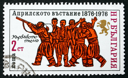 proclamation: BULGARIA - CIRCA 1976: a stamp printed in the Bulgaria shows Peasants with Rifle and Proclamation, Centenary of Uprising Against Turkey, circa 1976