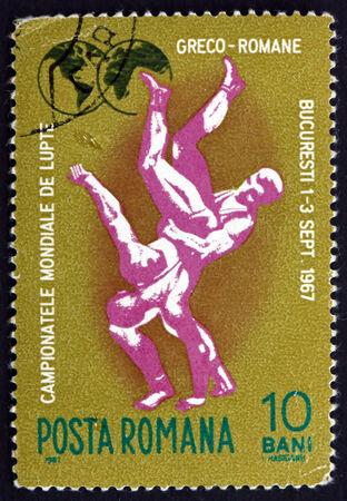 ROMANIA - CIRCA 1967: a stamp printed in the Romania shows Wrestlers, World Greco-Roman Wrestling Championships, Bucharest, circa 1967