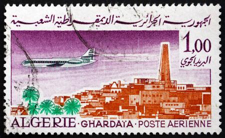 ALGERIA - CIRCA 1967: a stamp printed in Algeria shows Caravelle over Ghardaia, circa 1967