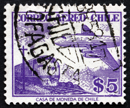 CHILE - CIRCA 1956: a stamp printed in the Chile shows Train and Plane, circa 1956