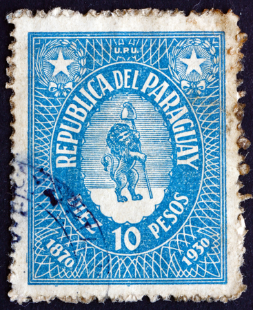vigilant: PARAGUAY - CIRCA 1939: a stamp printed in Paraguay shows Vigilant Lion Supporting Liberty Cap, 1st Paraguayan Postage Stamp, 60th Anniversary, circa 1939