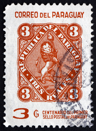 vigilant: PARAGUAY - CIRCA 1970: a stamp printed in Paraguay shows Vigilant Lion Supporting Liberty Cap, 1st Paraguayan Postage Stamp, Centenary, circa 1970