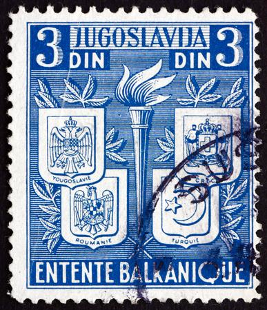 yugoslavia: YUGOSLAVIA - CIRCA 1940: a stamp printed in the Yugoslavia shows Coats of Arms of Yugoslavia, Greece, Romania and Turkey, Balkan Entente, circa 1940