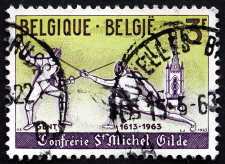 fencers: BELGIUM - CIRCA 1963: a stamp printed in the Belgium shows Modern Fencers, 350th Anniversary of the Granting of a Charter to the Ghent Guild of Fencers, circa 1963
