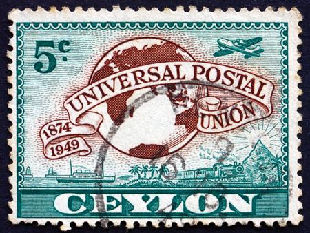upu: SRI LANKA - CIRCA 1949: a stamp printed in Sri Lanka shows Lion Rock and UPU Symbols, circa 1949