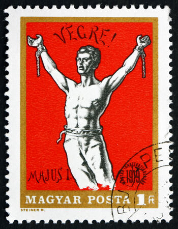 HUNGARY - CIRCA 1969: a stamp printed in the Hungary shows Man Breaking Chains, Revolutionary Poster, circa 1969